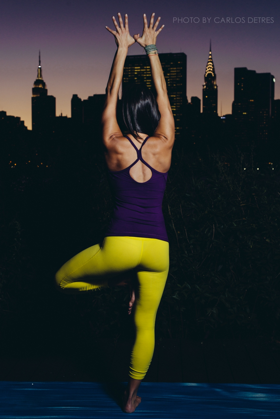 A Yoga Instructor with the Manhattan Skyline in the Background